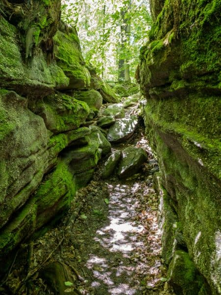 Hiking between boulders at Panama Rocks near Jamestown, New York