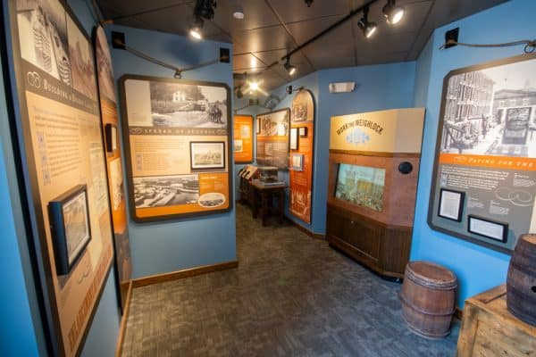 Historical information inside Syracuse's Erie Canal Museum.