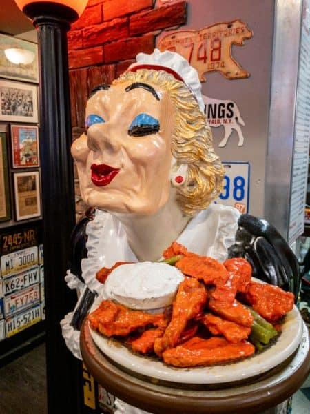 Lady with Buffalo Wings at Anchor Bar in Buffalo, NY