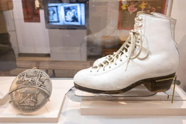 Olympic medal and figure skates at the Lake Placid Olympic Museum in New York