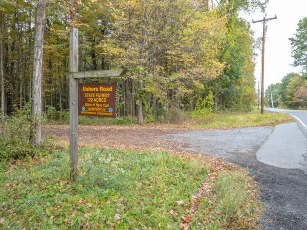 Sign for Ushers Road State Forest's parking area