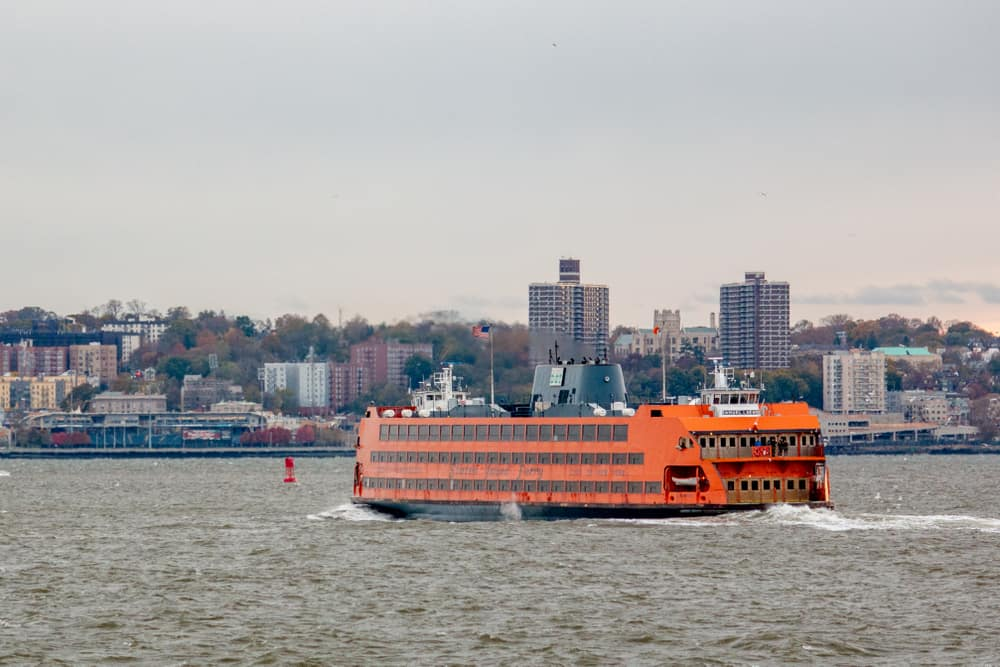 A Staten Island Ferry passes through New York City