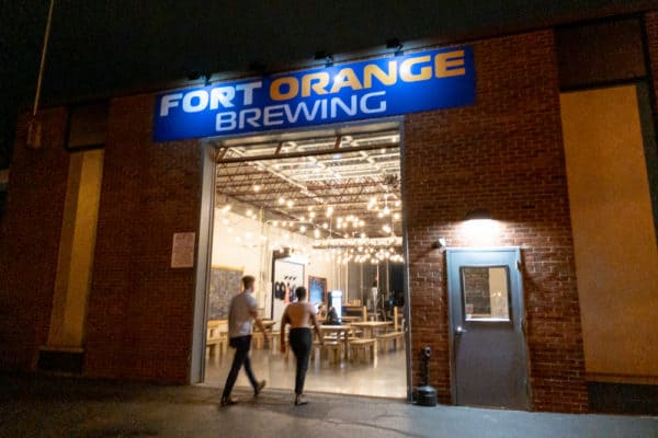 People entering Fort Orange Brewing in Albany New York