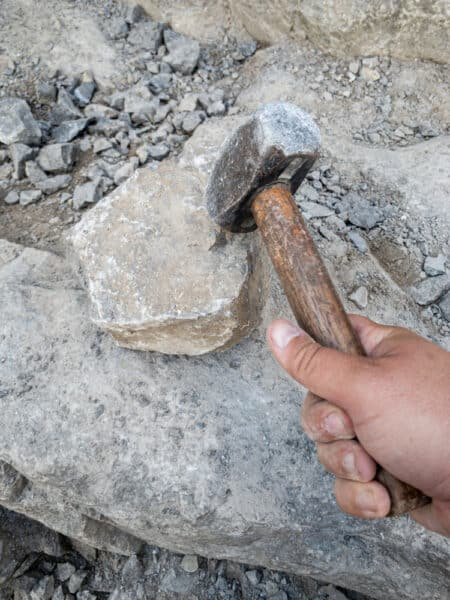 Hitting a rock with a sledgehammer at the Herkimer Diamond Mines in Herkimer New York