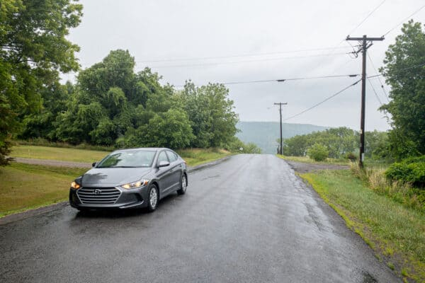 Car sitting at Spook Hill in Middlesex, New York