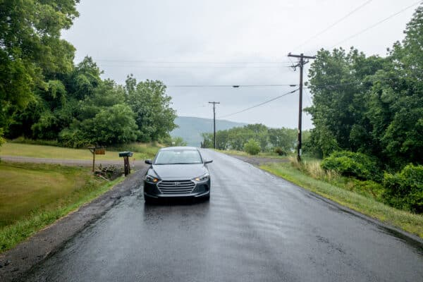 Car sitting on the Gravity Hill in Yates County New York