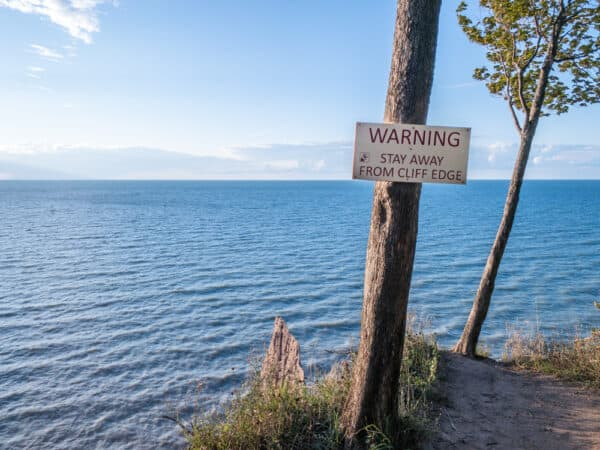 Warning sign at Chimney Bluffs State Park near Wolcott NY