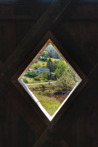 Looking through a window in Fitches Covered Bridge in the Catskills