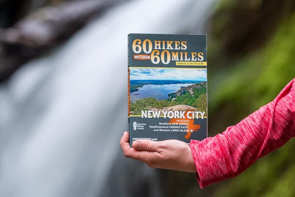 Woman holding New York Hiking Books