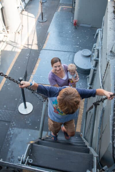 Child climbing a ladder on the USS The Sullivans at the Buffalo Naval Park in western New York