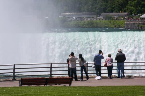 Visitors in front of Horseshoe Falls at New York's Niagara Falls State Park