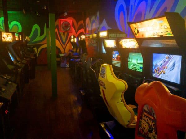 Driving arcade games at Robot City Arcade in Binghamton New York