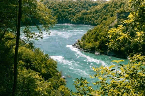 Looking upriver through the trees towards the Niagara Whirlpool in Niagara Falls New York